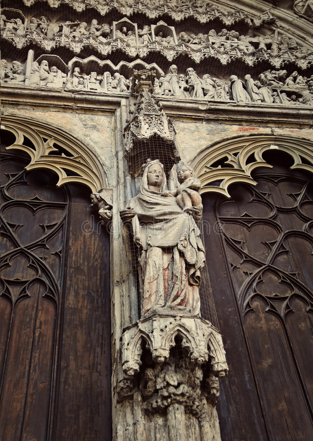 Detail of Cathedral of St. Maria, Augsburg. Figure of Virgin Maria with baby on facade of Cathedral of St. Maria (Dom Unserer Lieben Frau) in Augsburg, Germany royalty free stock images
