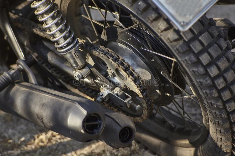 Detail of the chained transmission of a vintage motorcycle. stock image