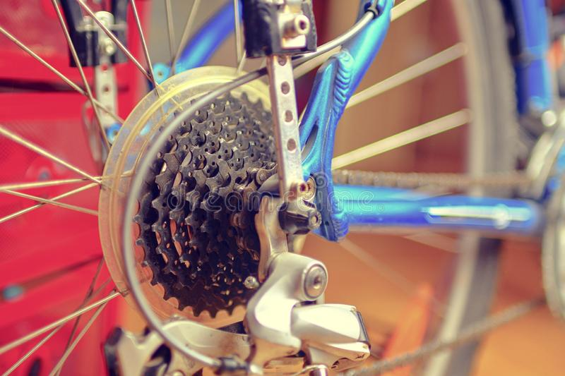 Detail of change- speed on bicycle. Bike speed changing assembly. Rear wheel. Steel bicycle chain. Transmission gears stock photography
