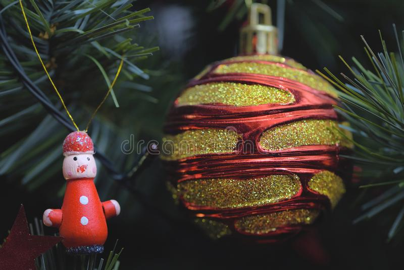 Detail of Christmas decoration on tree with coloured lights. Christmas tree in background stock photos