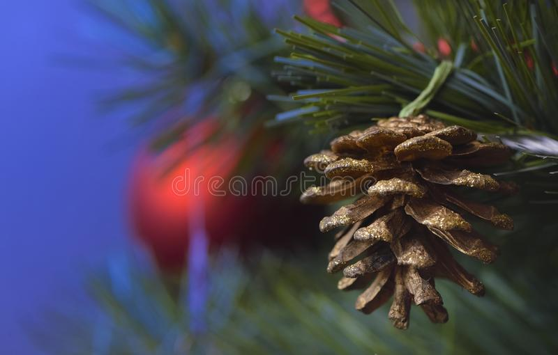 Detail of Christmas decoration on tree with coloured lights. Christmas tree in background royalty free stock images