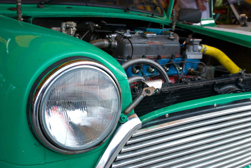 Detail of classic compact car. Front detail and engine of classic compact car from the sixties royalty free stock images
