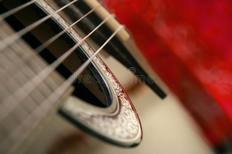 Detail on classical guitar six string, shallow depth of focus, w royalty free stock photography
