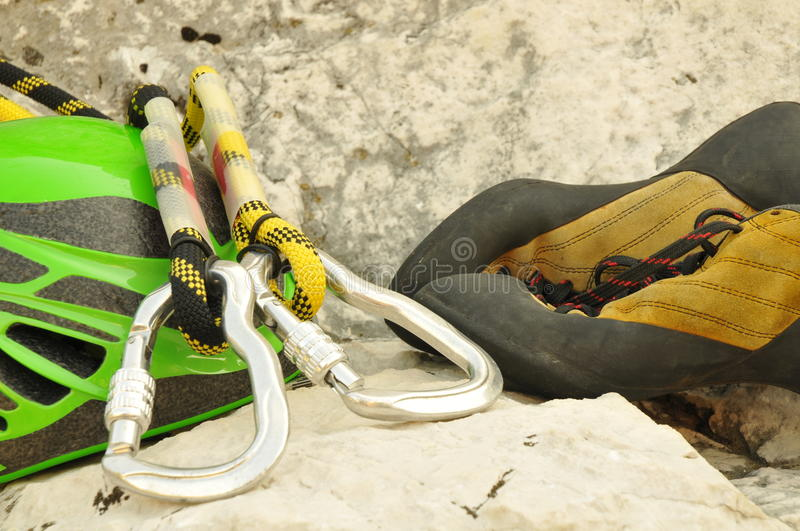 Detail of climbing helmet, carabiner and shoes royalty free stock photography