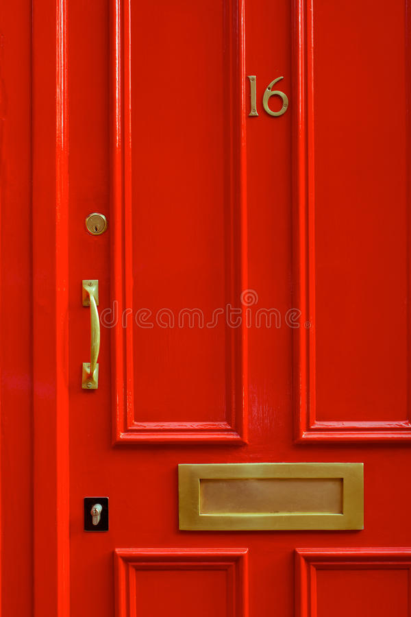 Detail Close-up of a Bright Red Door in London England royalty free stock photos