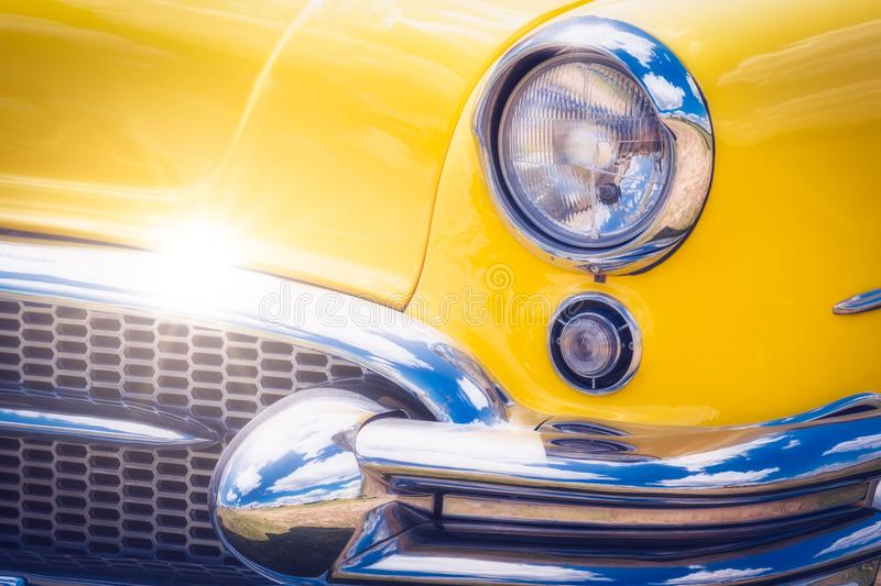 Detail of colorful yellow vintage car headlights stock image