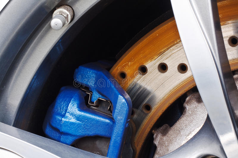 Disc Brakes. Detail close up of a motor vehicle or car disc brake showing the rotor and the caliper stock images