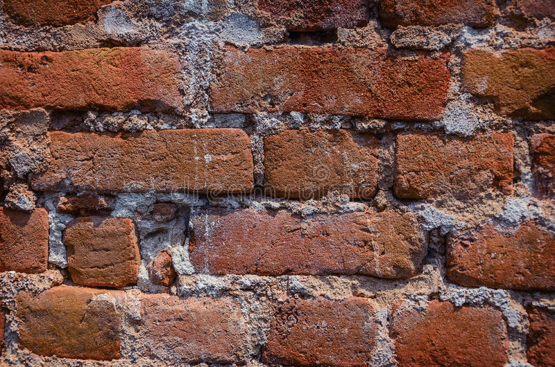 Detail close up of an old uneven brick wall. royalty free stock photos