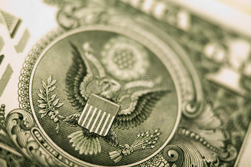Detail closeup dollar. Money is any good or token used by a society as a medium of exchange, store of value and unit of account. Trade without money requires royalty free stock photo