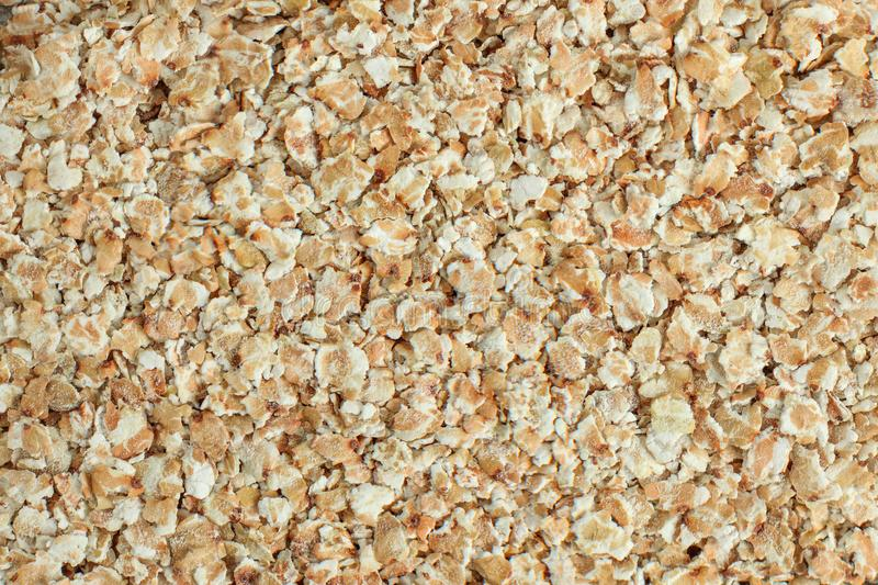 Detail closeup photo of white buckwheat flakes from above. royalty free stock photos