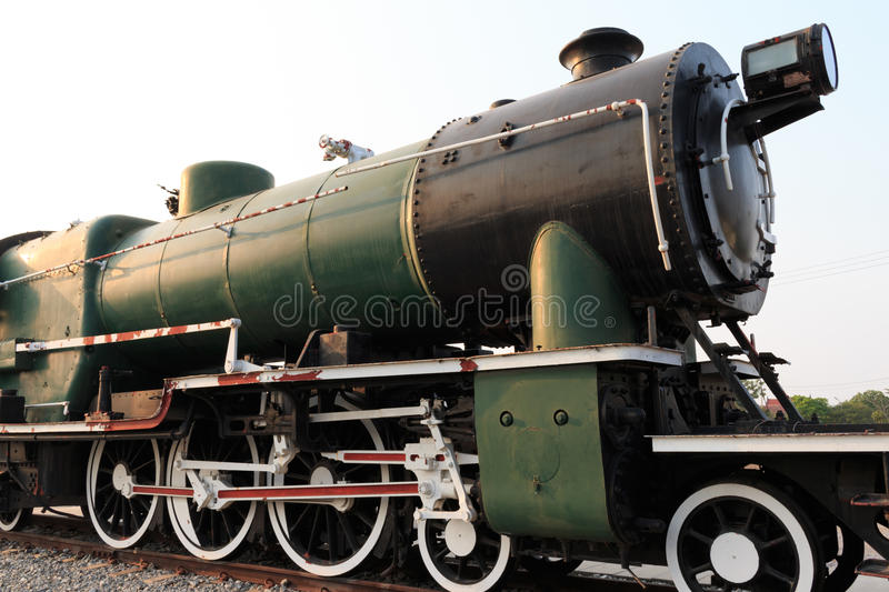A detail closeup of a steam locomotive releasing steam. Vintage train. royalty free stock images