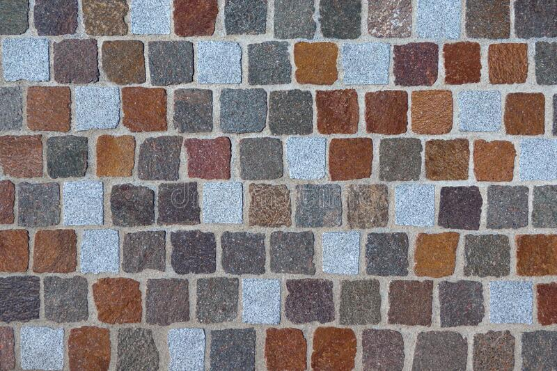 Detail of a cobblestone made of different colored paving stones royalty free stock image