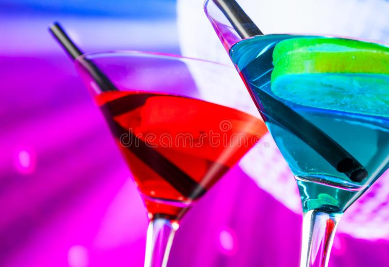 Detail of cocktail with sparkling disco ball background with space for text royalty free stock photo