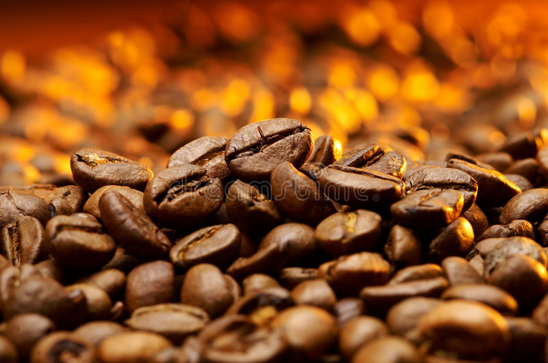 A detail of coffe grains. With warm background
