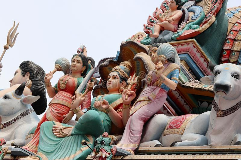 Detail of the colored wood statue on the roof of the Sri Mariamman Hindu temple in Chinatown Singapore royalty free stock photo