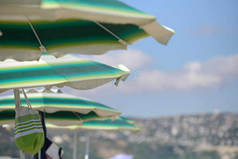 Detail of colorful umbrellas on the beach on a sunny summer day. stock photography