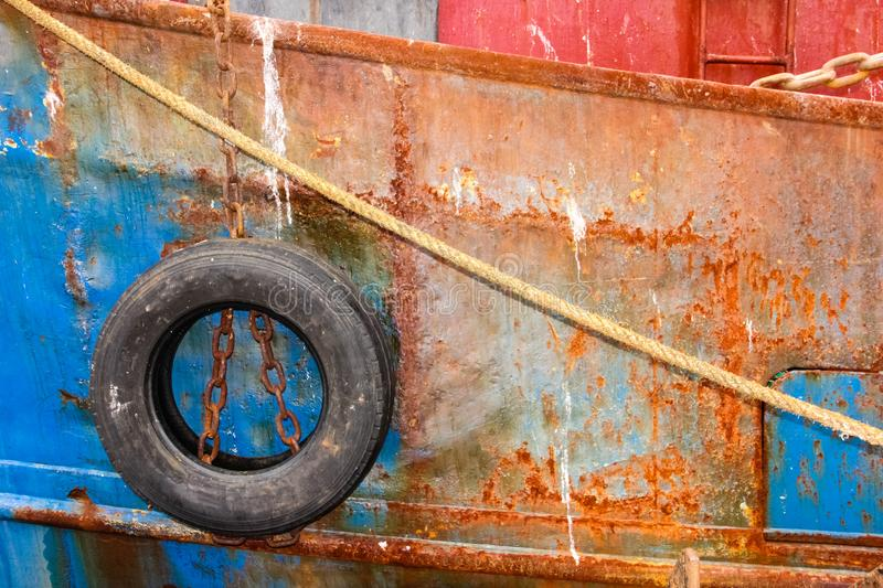 Detail. fishing boat. colourful rusty hull. royalty free stock photo