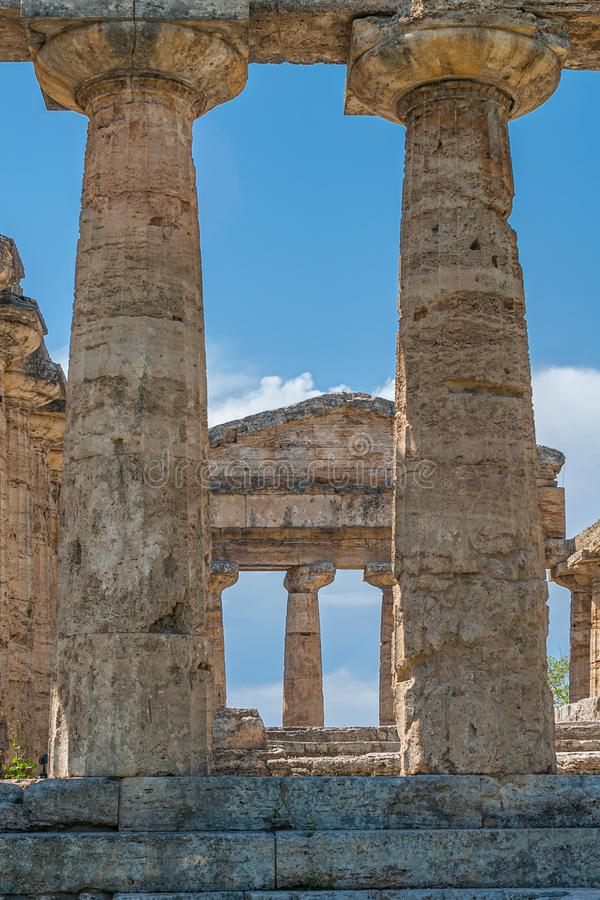 Detail of the columns of the Temple of Athena, Greek Goddess of wisdom, arts and war. Of the archaeological area of Paestum royalty free stock photo
