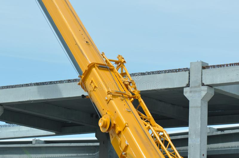 Construction crane. Detail of construction crane with blurry sky on the background stock image