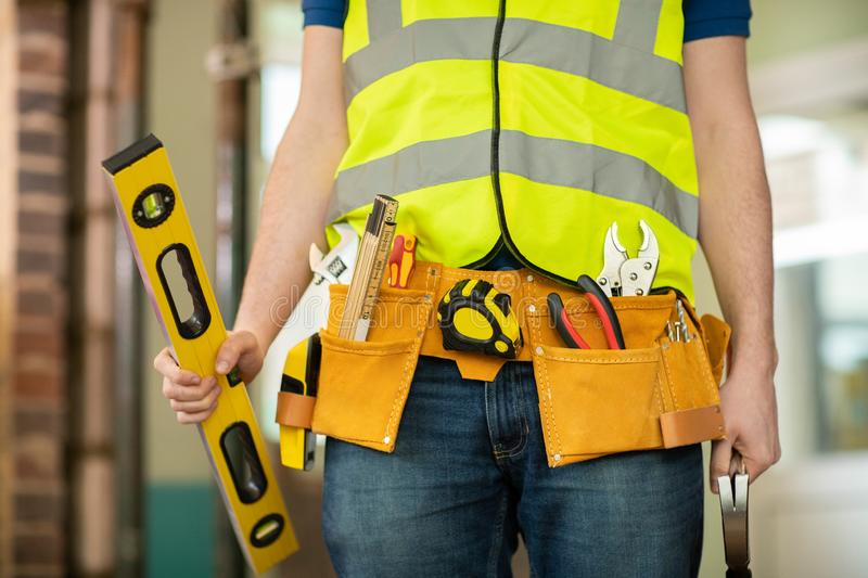 Detail Of Construction Worker On Building Site Wearing Tool Belt stock images