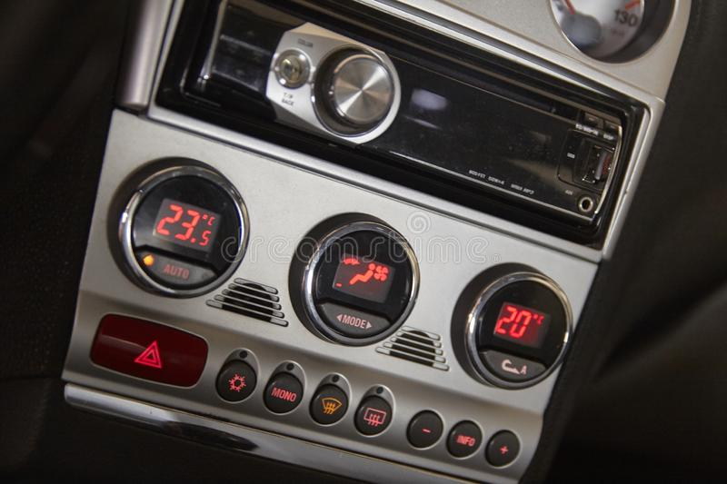 Two-zone air conditioner in a car. Detail of the control panel of a two-zone air conditioner in a car royalty free stock image