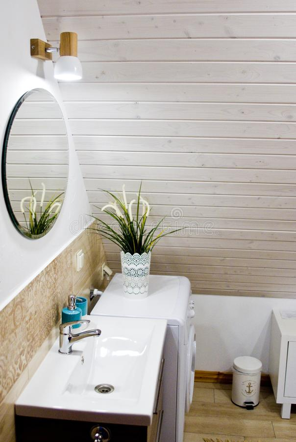 Loft bathroom with wooden ceiling detail royalty free stock photography