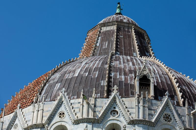 Cupola of the Pisa Baptistery of St. John against a beautiful blue sky. Detail of the cupola of the Pisa Baptistery of St. John against a beautiful blue sky royalty free stock photo
