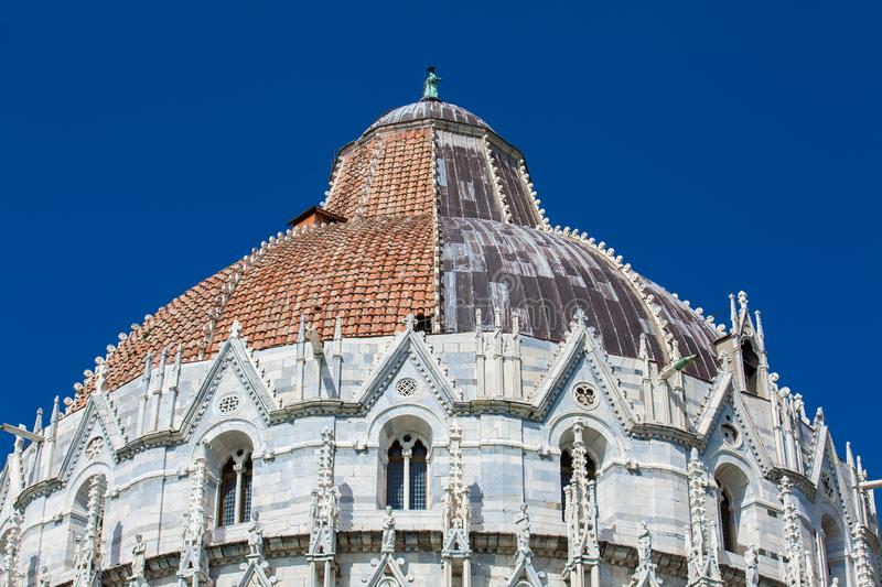 Cupola of the Pisa Baptistery of St. John against a beautiful blue sky. Detail of the cupola of the Pisa Baptistery of St. John against a beautiful blue sky royalty free stock photography