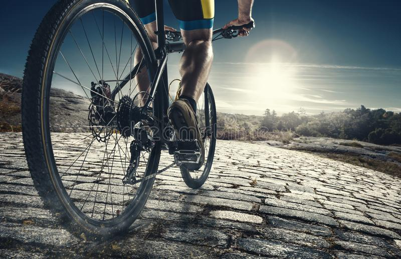 Detail of cyclist man feet riding mountain bike on outdoor trail on country road stock photo