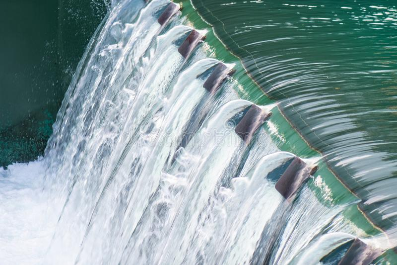 Detail of a dam with flowing water stock photo