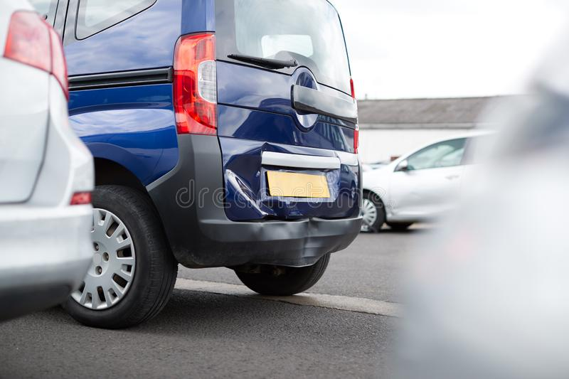 Detail Of Damage To Rear Bumper Of Vehicle In Car Park royalty free stock photo