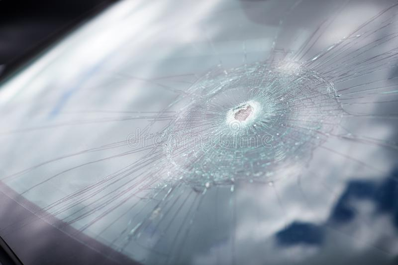 Detail Of Damage To Windscreen Of Car Shattered By Vandalism royalty free stock photography