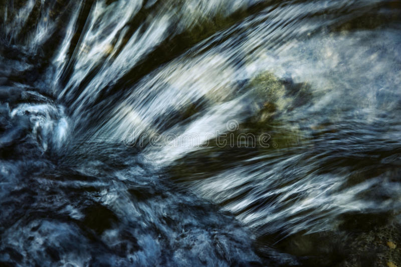 Detail of a dark ripple on the river royalty free stock photos