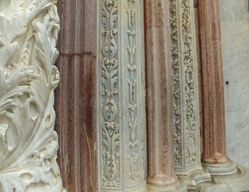 Detail of the decoration of Siena Cathedral. Red and white carved marble stock photos