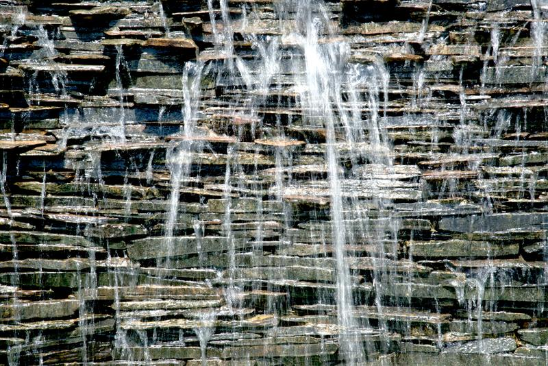 Detail of a decorative waterfall in the garden. royalty free stock images