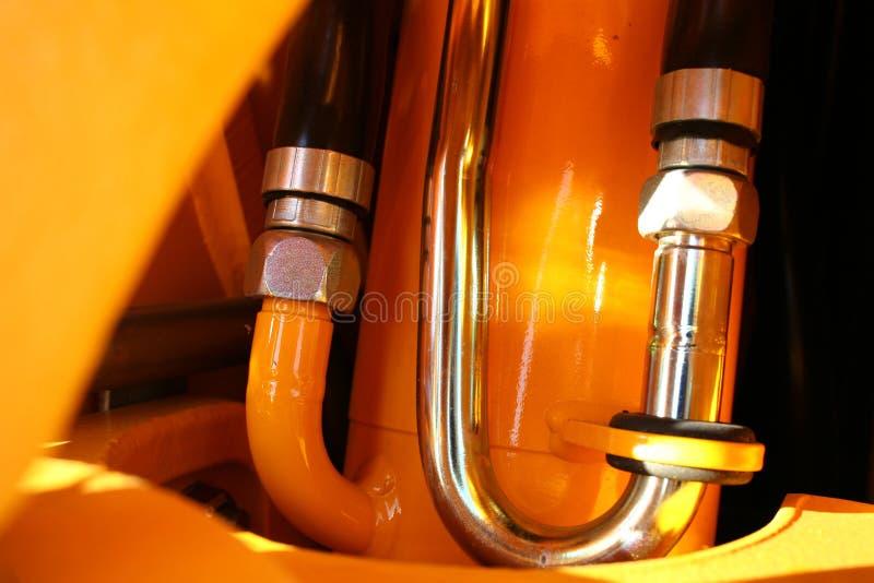 Detail der Hydraulikanlage eines Traktors lizenzfreie stockbilder