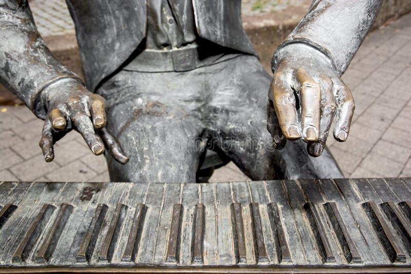 Detail der Pianiststatue lizenzfreie stockfotografie