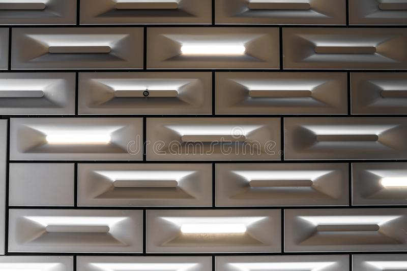 Detail design of aluminium ceiling block in brick pattern with led lighting integrated  in surface / detail aluminium / abstract b royalty free stock image