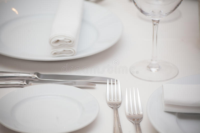Detail of a dining table set up with wine glasses.  royalty free stock photo