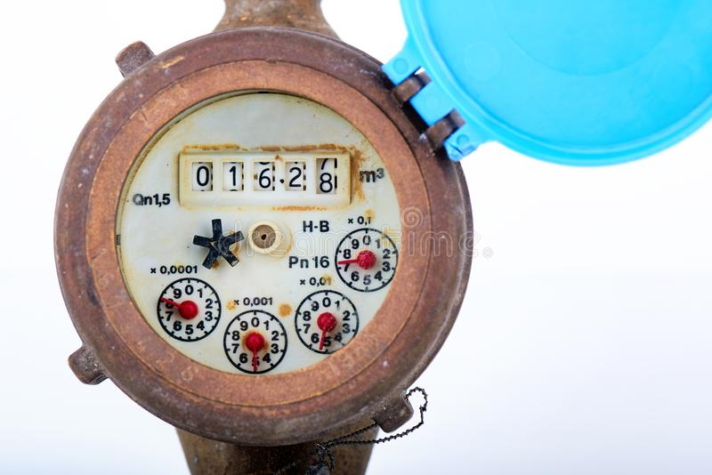 Old water meter. Detail of dirty old water meter clock - shows water consumption royalty free stock images