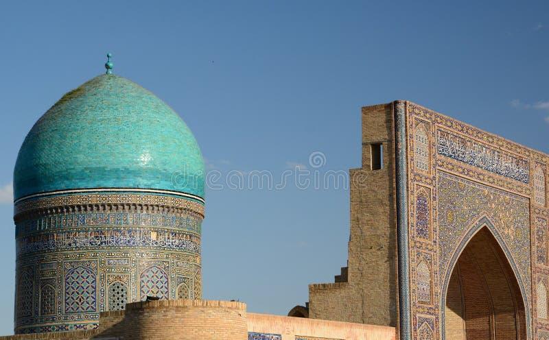 Detail of the dome and the portal. Mir-i-Arab madrasah. Po-i-Kalyan complex. Bukhara. Uzbekistan. Bukhara is a city in Uzbekistan, located on the ancient Silk stock photo