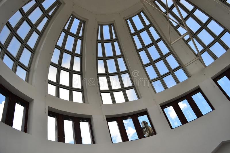 Detail of the dome roof of historical building with windows. A dome roof with windows in historical building in Prague, detail of unique architecture royalty free stock photos