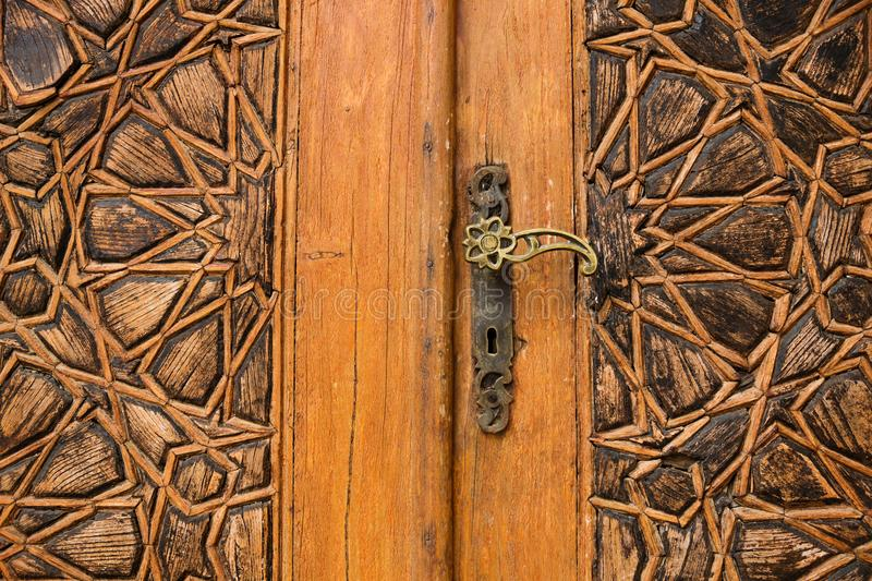 Detail of a door with arab ornaments at Emir Bachir Chahabi Palace Beit ed-Dine in mount Lebanon Middle east, Lebanon. Detail of a wooden door with arab stock photography