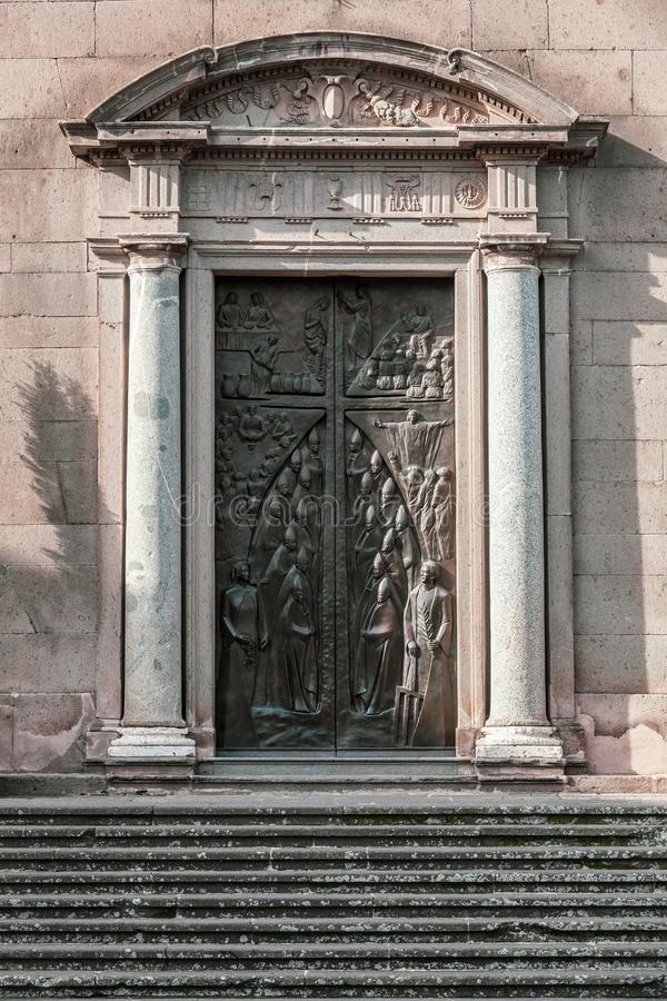 Detail of the door with columns and bas-relief. Viterbo Cathedral. Italian: Duomo di Viterbo. royalty free stock photos