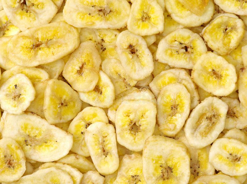 Detail of dried banana chips - full frame. Background royalty free stock image