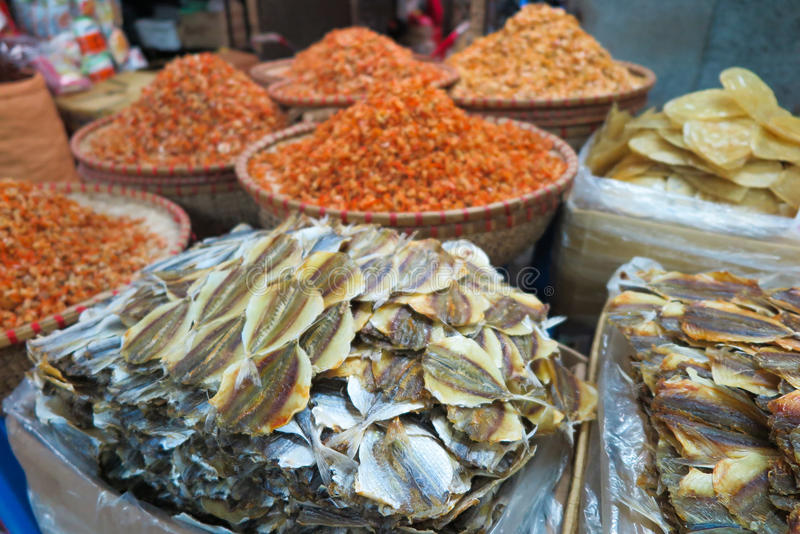 A detail of dried fish and seafood sold in the streetmarket, Vietnam. Streetmarket with dried fish, shrimps and seafod royalty free stock photo