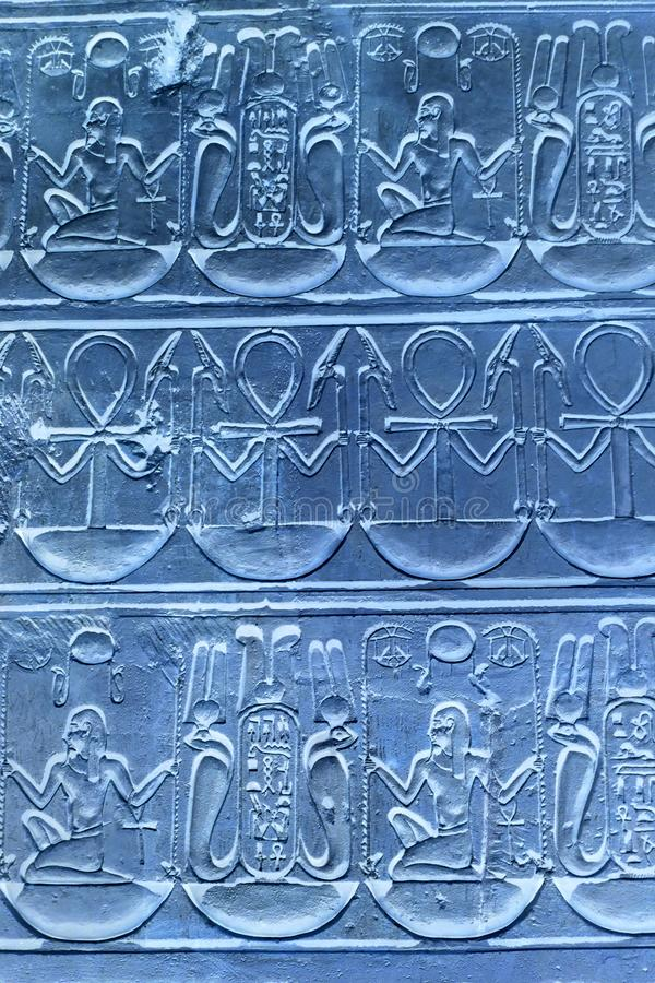 Detail of Ancient Hieroglyphics Blue. Detail of Egyptian hieroglyphics featuring the symbol of the ankh. Original image has been inverted to give the appearance royalty free stock photography