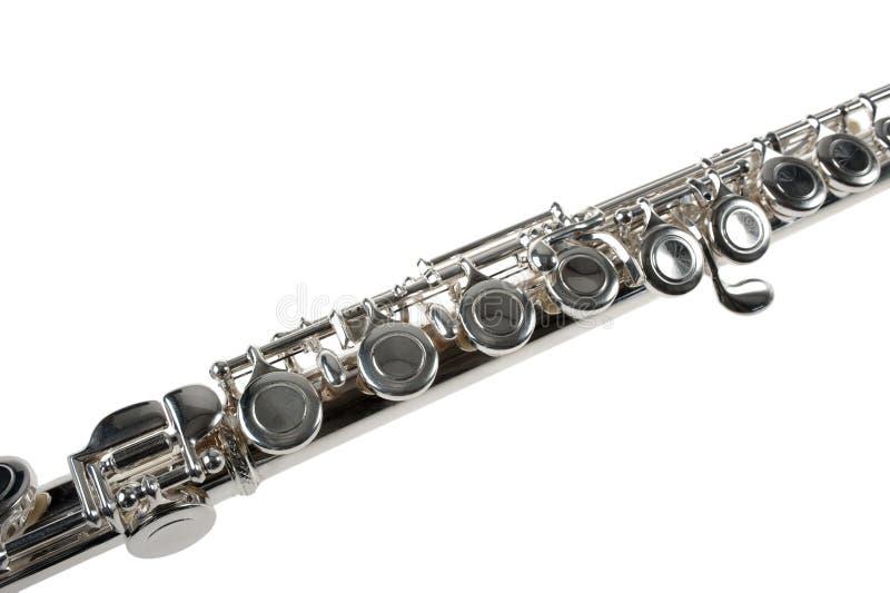 Detail einer silbernen Flöte auf Weiß lizenzfreie stockfotografie