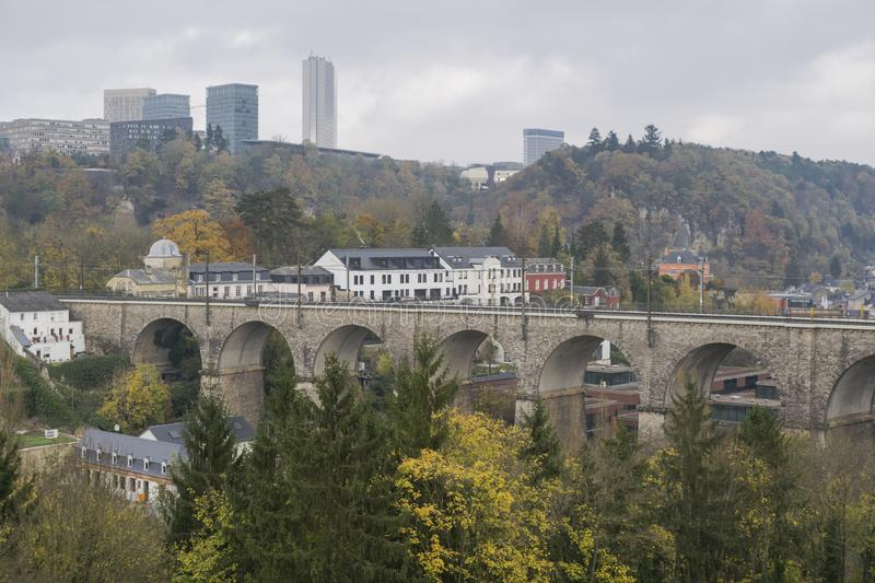 Detail of electrical railroad in Luxembourg city with rails, contact lines and viaduct structures. In dark autumn day illustrating urban transport concept stock images