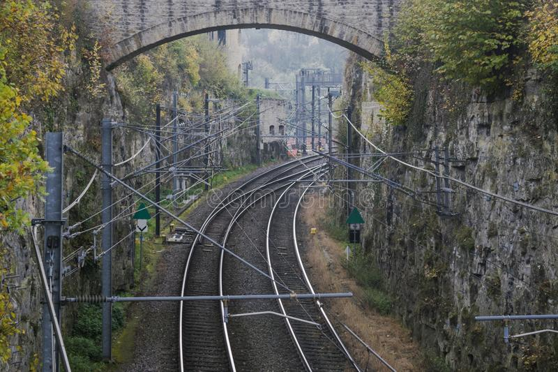 Detail of electrical railroad in Luxembourg city with rails, contact lines and viaduct structures. In dark autumn day illustrating urban transport concept royalty free stock photo